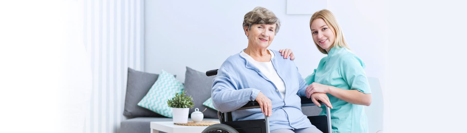 caregiver and elderly woman in a wheelchair